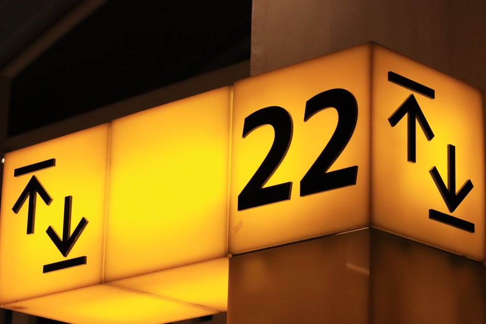 yellow and black 22 signage