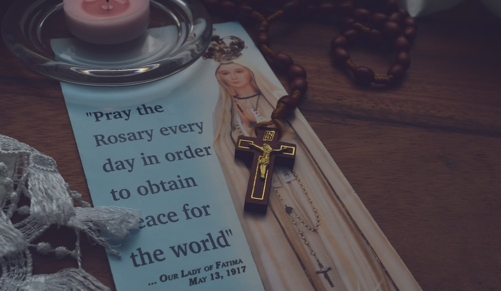 Virgin Mary photo and brown rosary