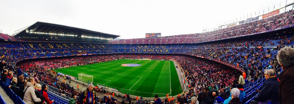 panoramic photography of people inside a soccer stadium