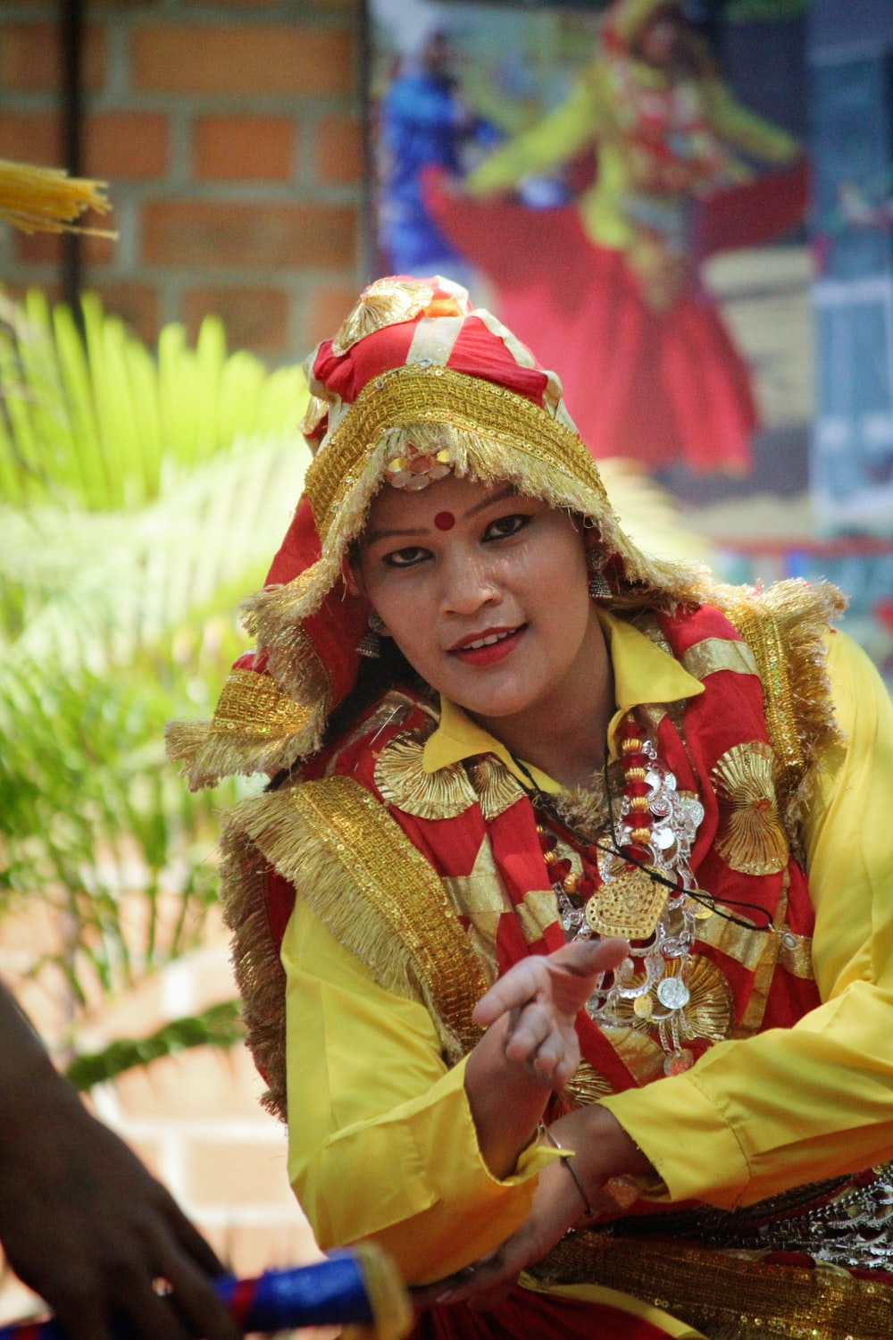 woman in red and yellow sari