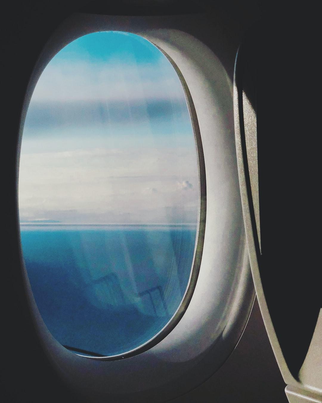 In an aeroplane over the sea.