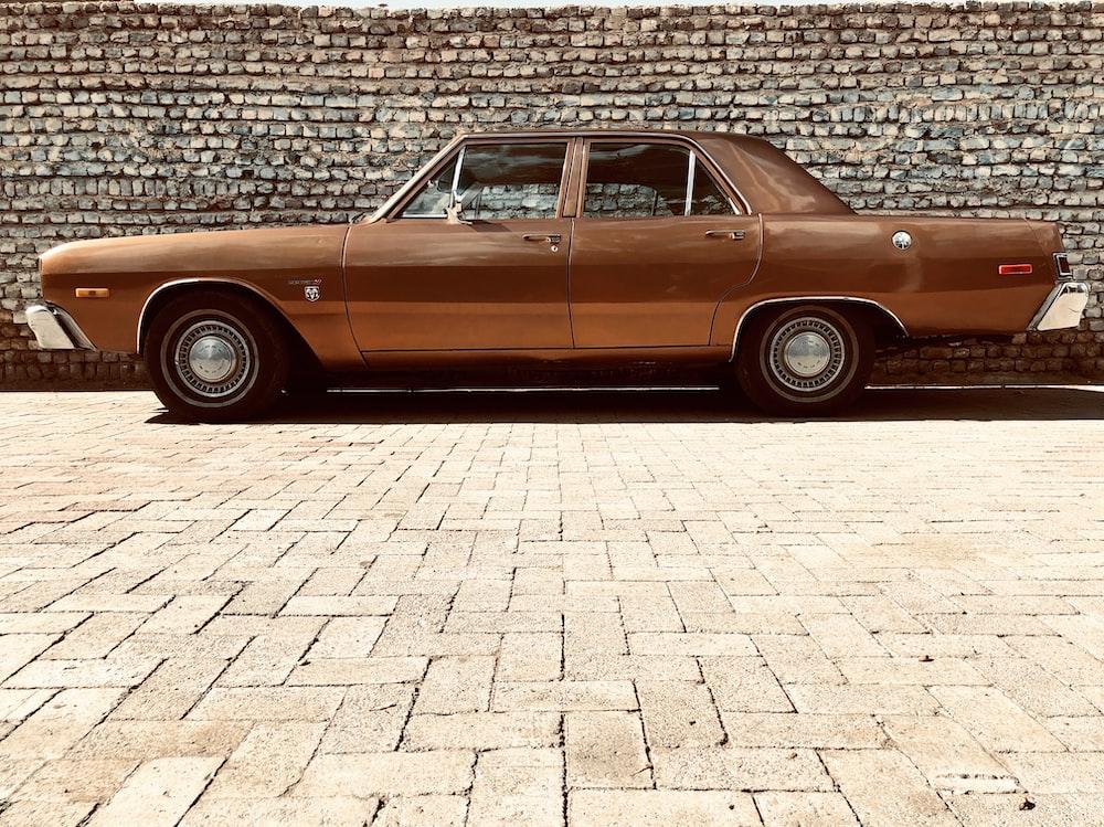brown sedan near wall