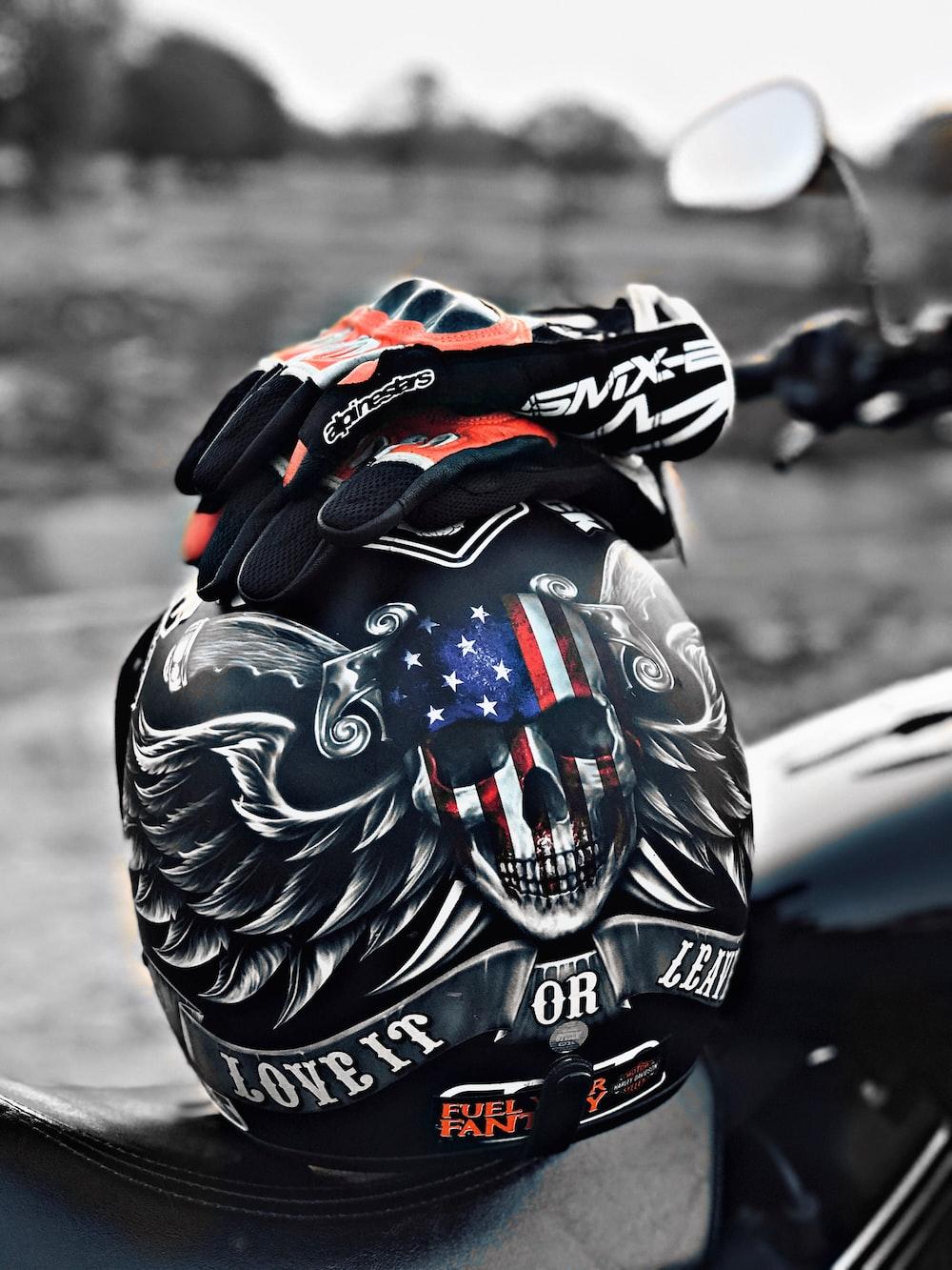 gloves on helmet on motorcycle