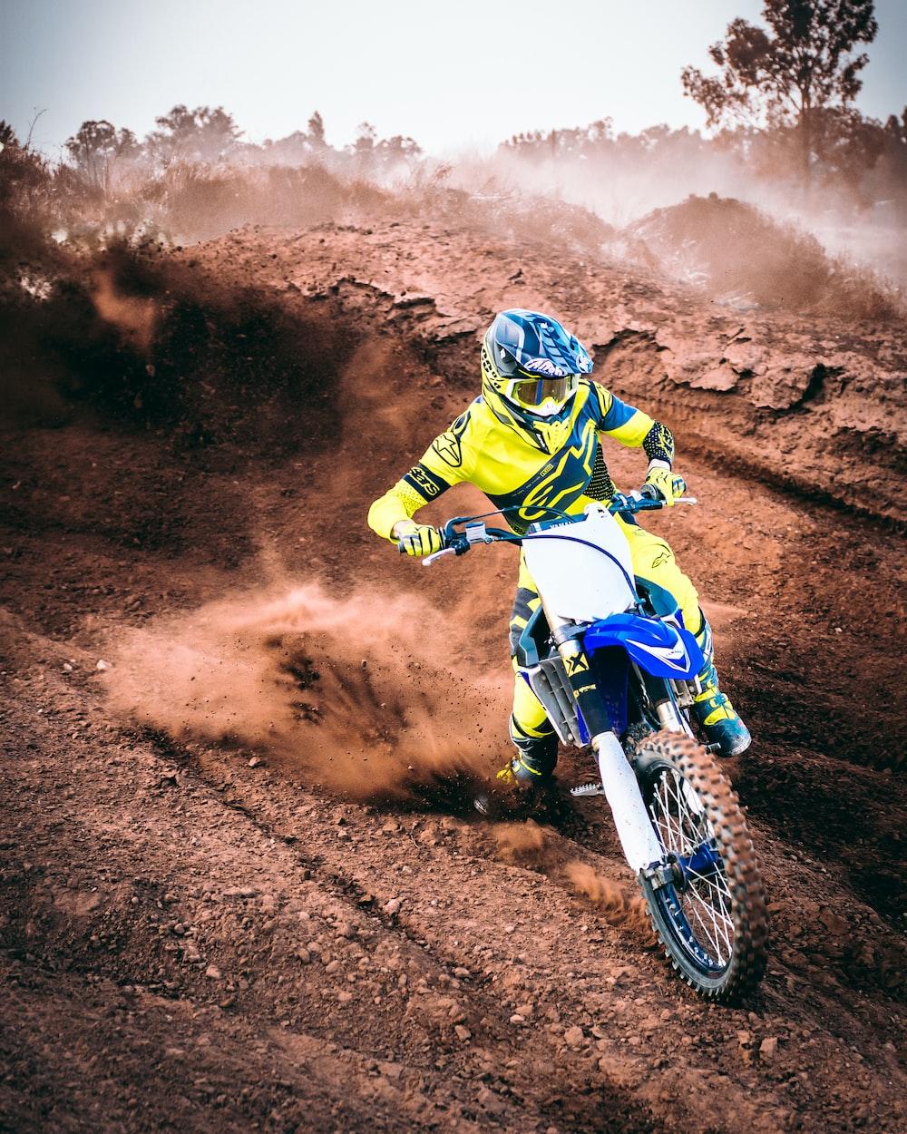 person rides motocross dirt bike