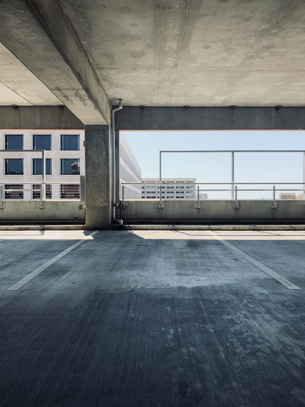 gray concrete parking area in building