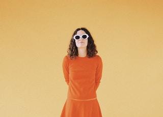 woman wearing orange long-sleeved dress