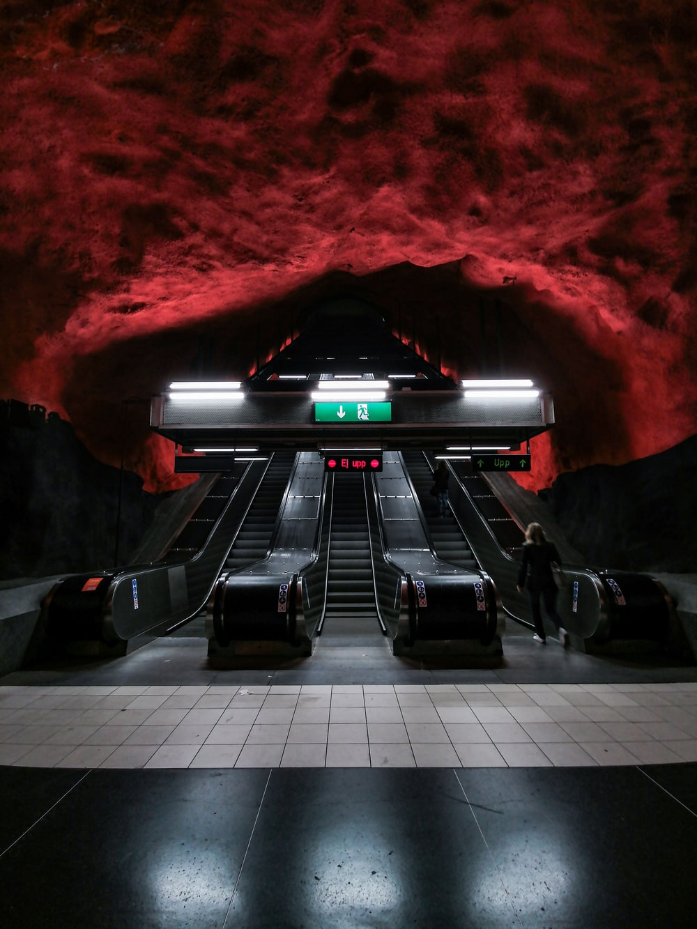 person riding escalator
