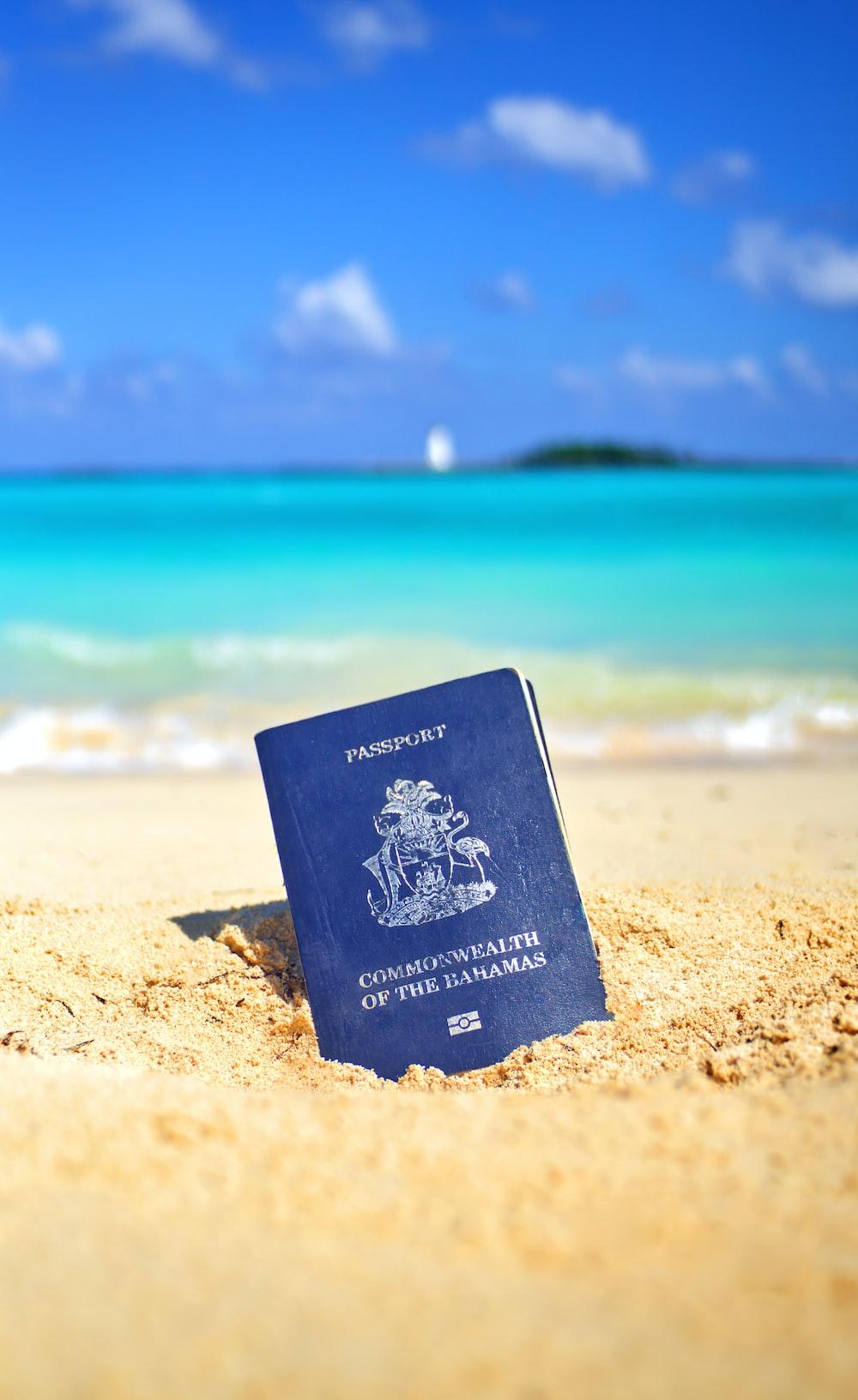 Passport book on seashore