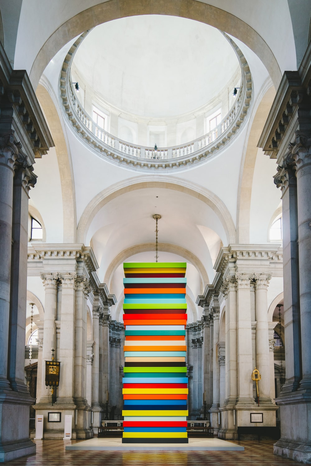 multicolored tower placed inside a museum