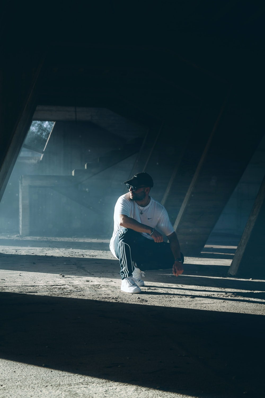 man sitting on a parking lot