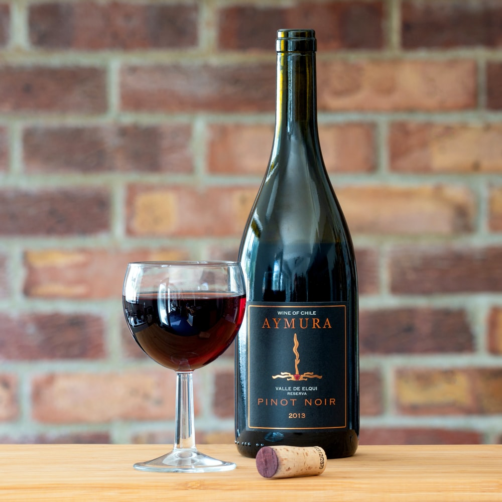 Aymura Pinot Noir Wine Bottle Photo Free Image On Unsplash