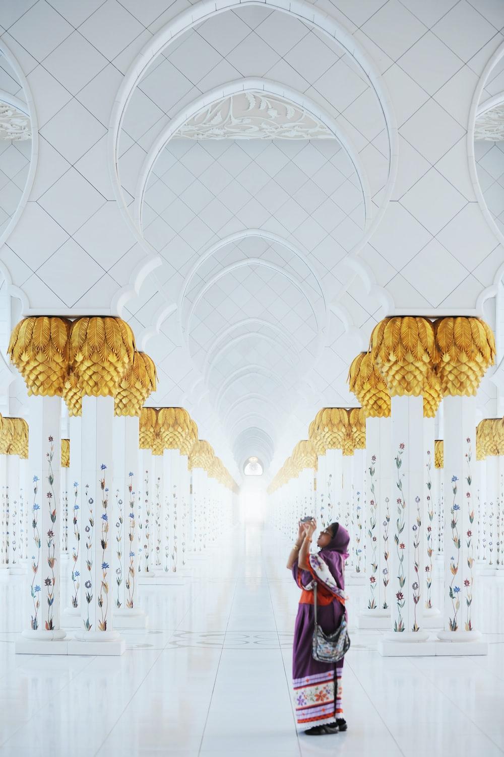 woman standing inside a prayer temple