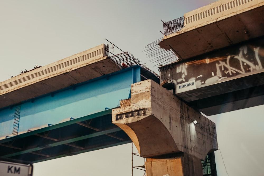 broken brown concrete bridge