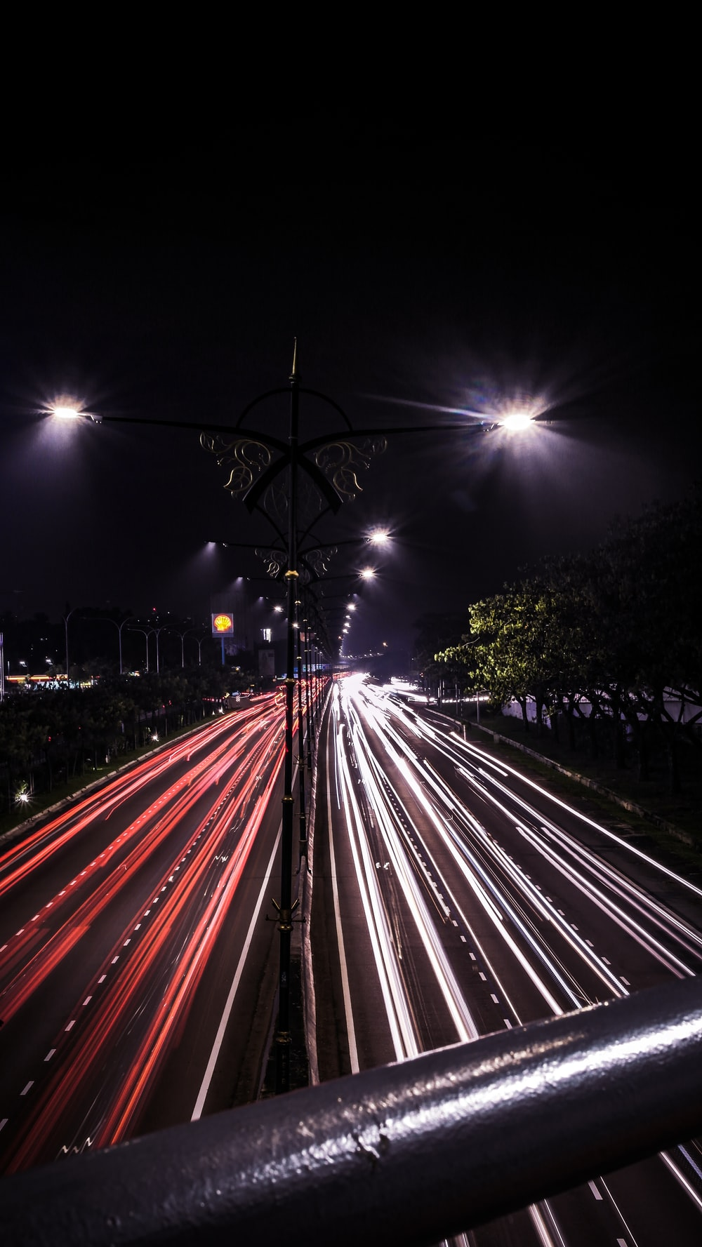 time lapse photo of cars passing by during nighttime