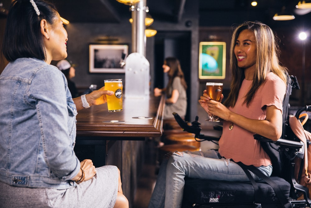 two women sitting at the table inside bar