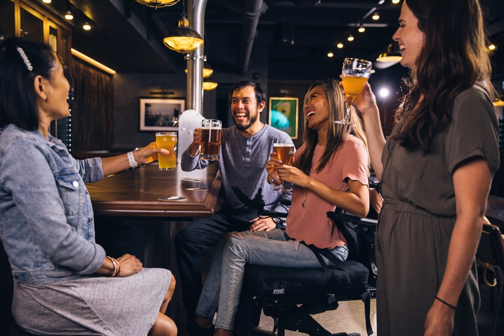 group of people drinking inside room