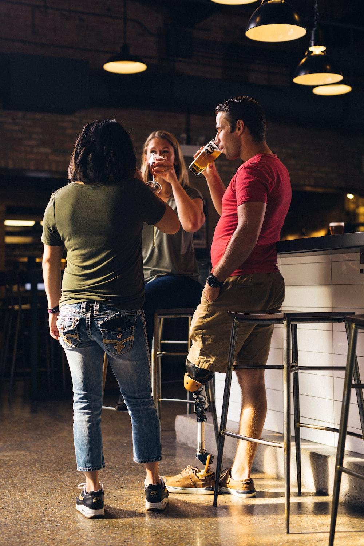 women and man standing beside counter