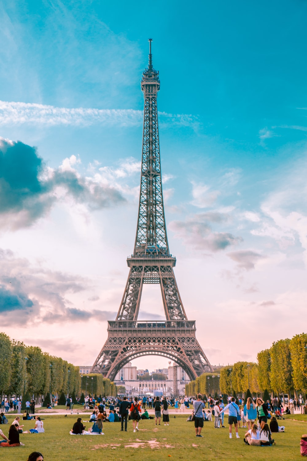 close-up photography of people near Eiffel Tower, Paris