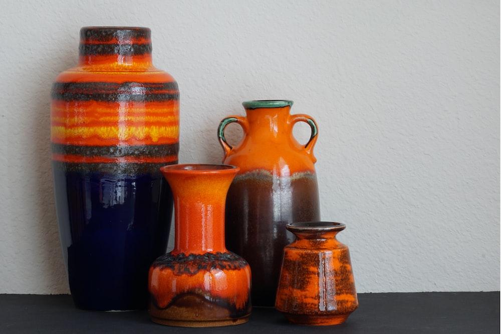 several assorted-color ceramic vases