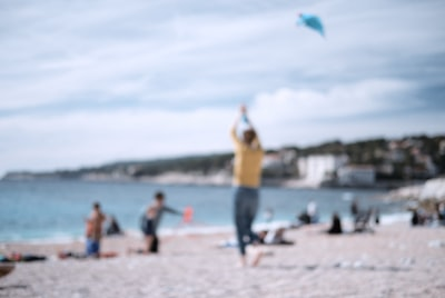 blur photography of people on shore