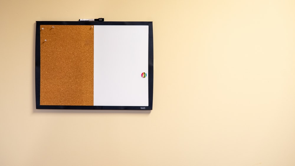 brown and white bulletin board