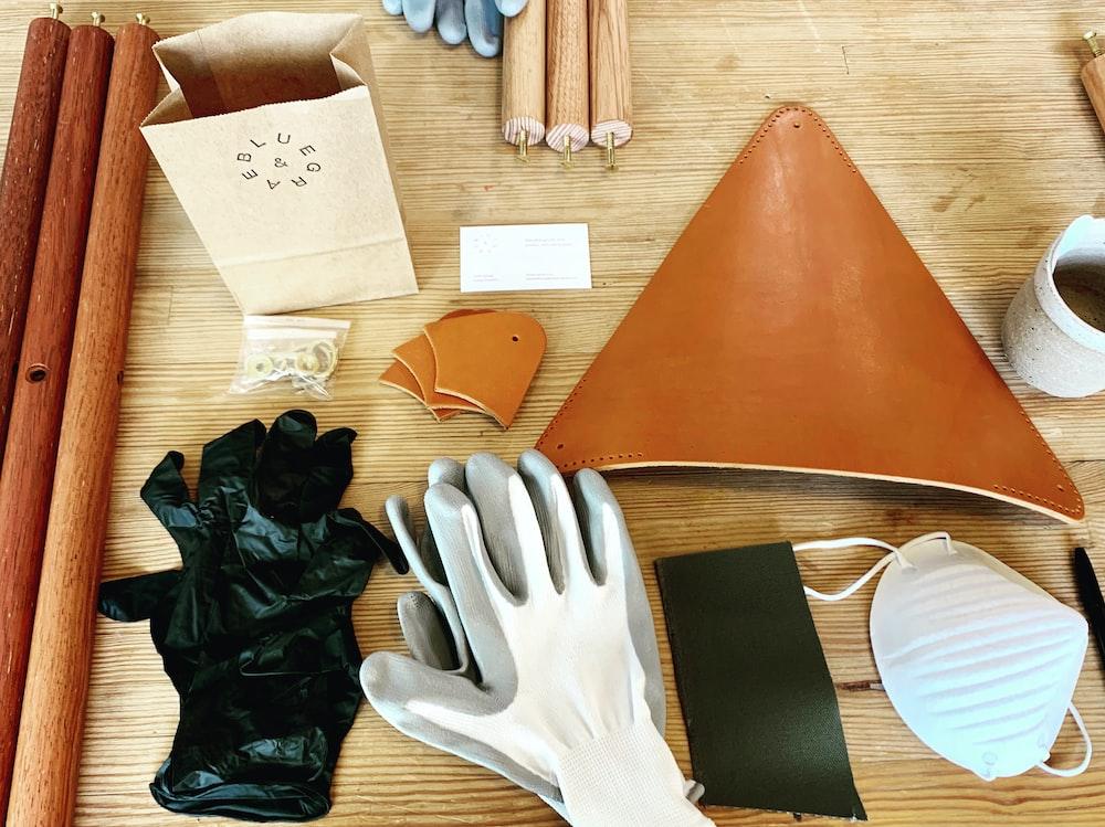 white gloves near wooden rods