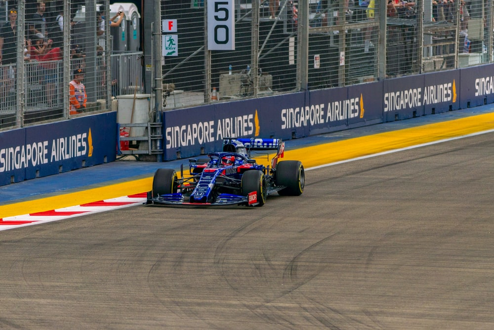 blue race car on track during daytime