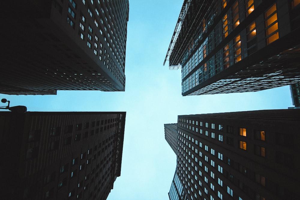 four brown high rise buildings