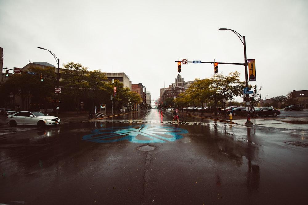 white sedan crossing intersection road