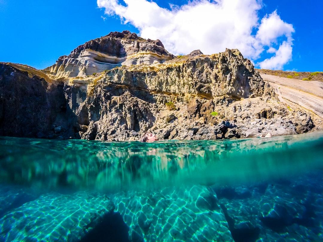 split screen under and over water in amazing coastline