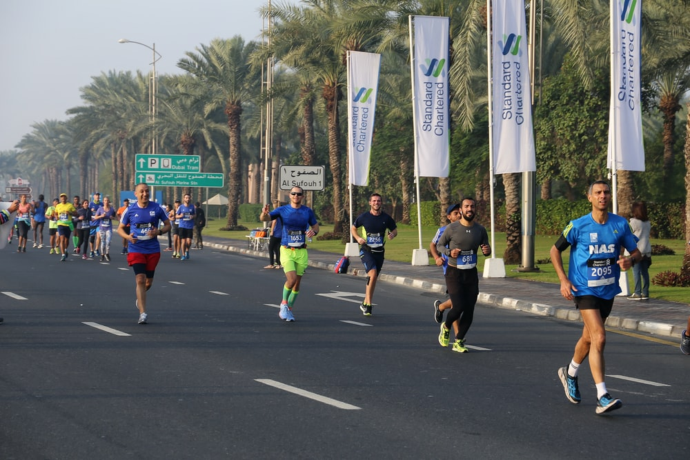 people running on road in event during daytime