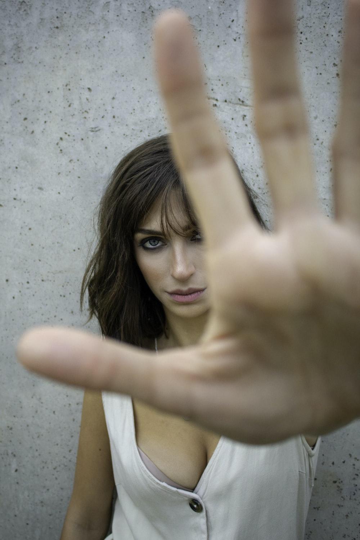 glaring woman reaching her hand