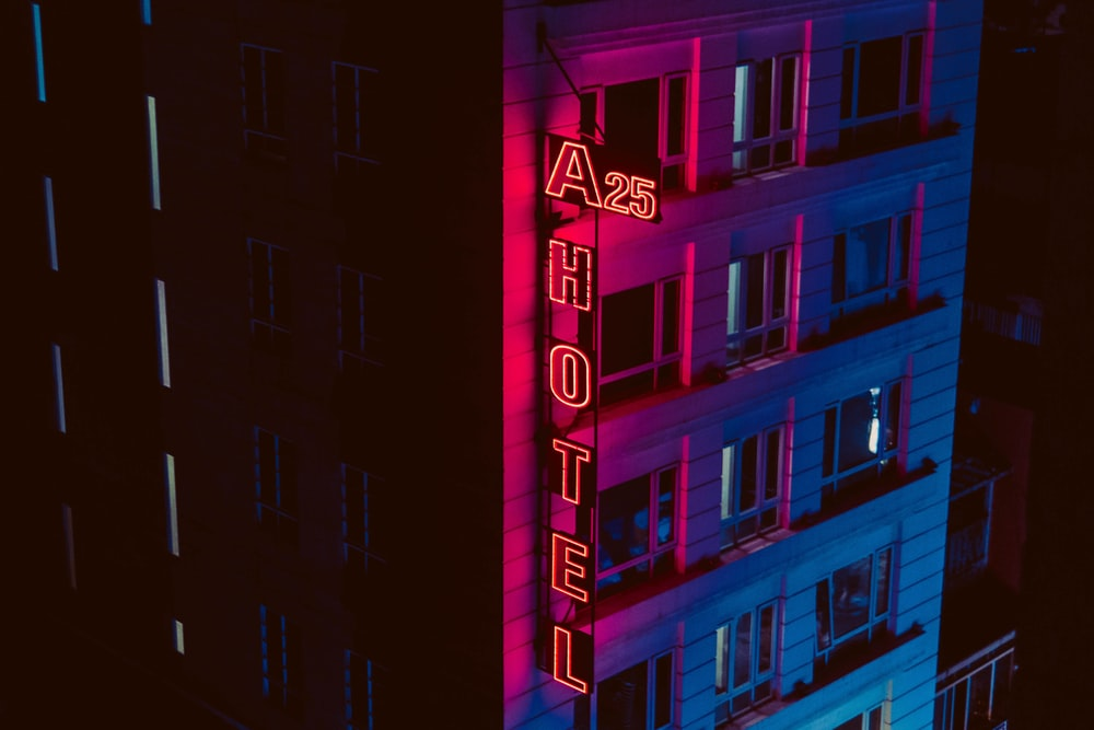 turned on A25 Hotel neon signage beside building during night