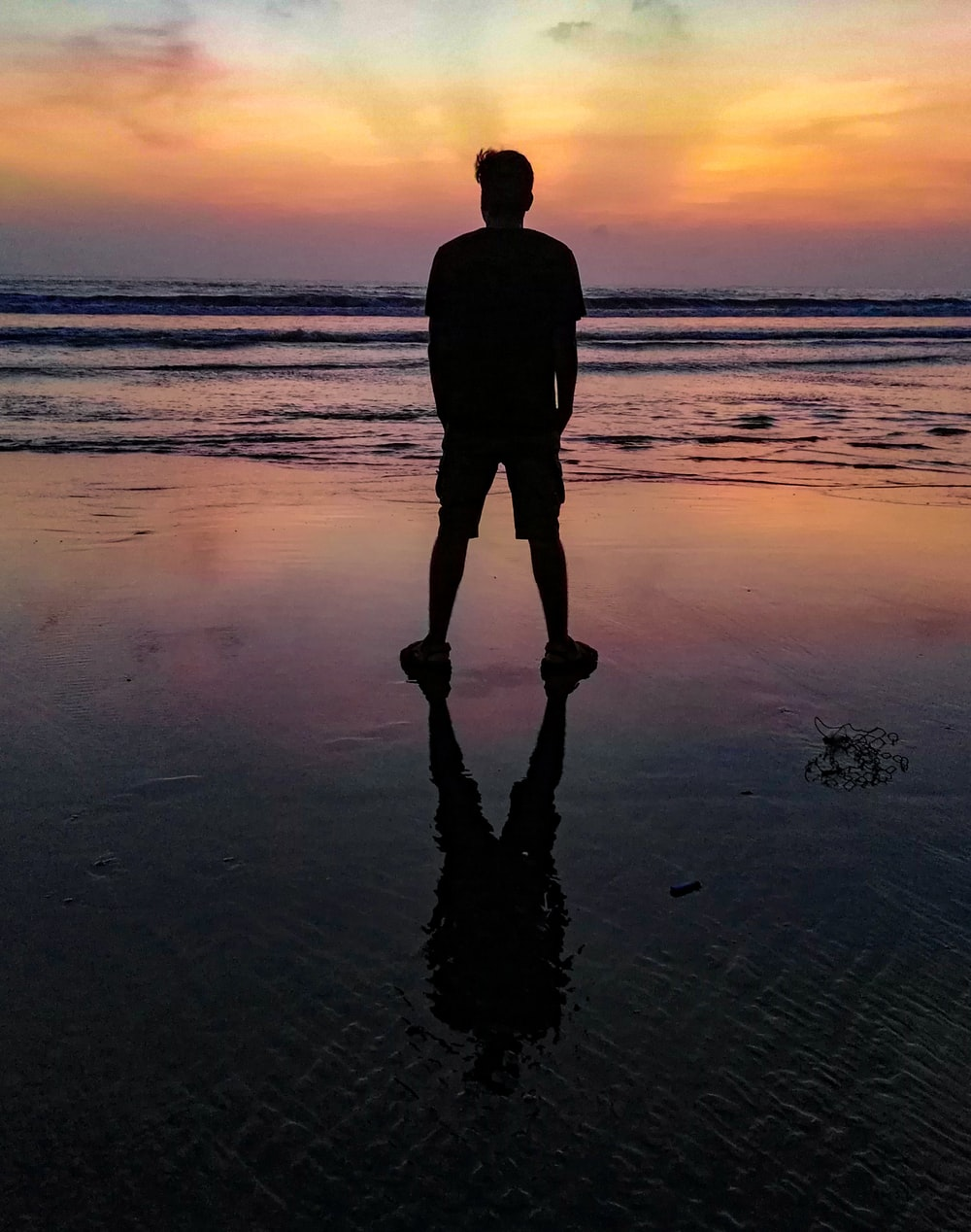 man standing on shore at night