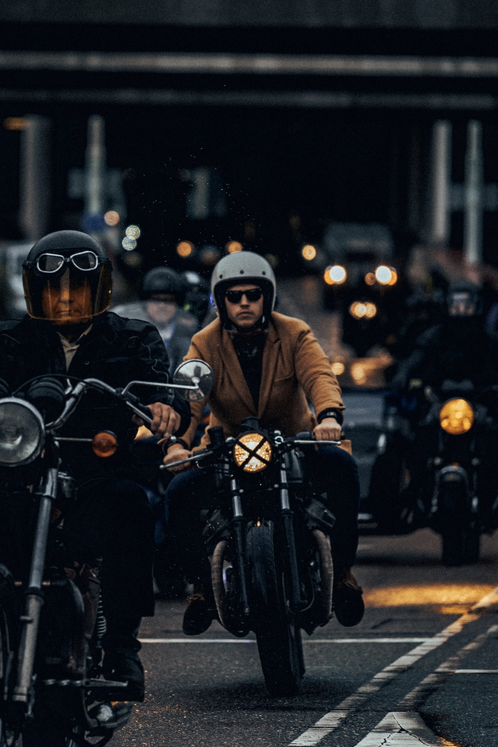 man riding on black motorcycle close-up photography