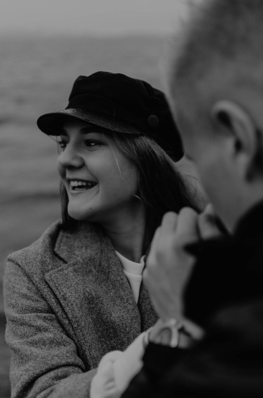 woman wears black flat cap
