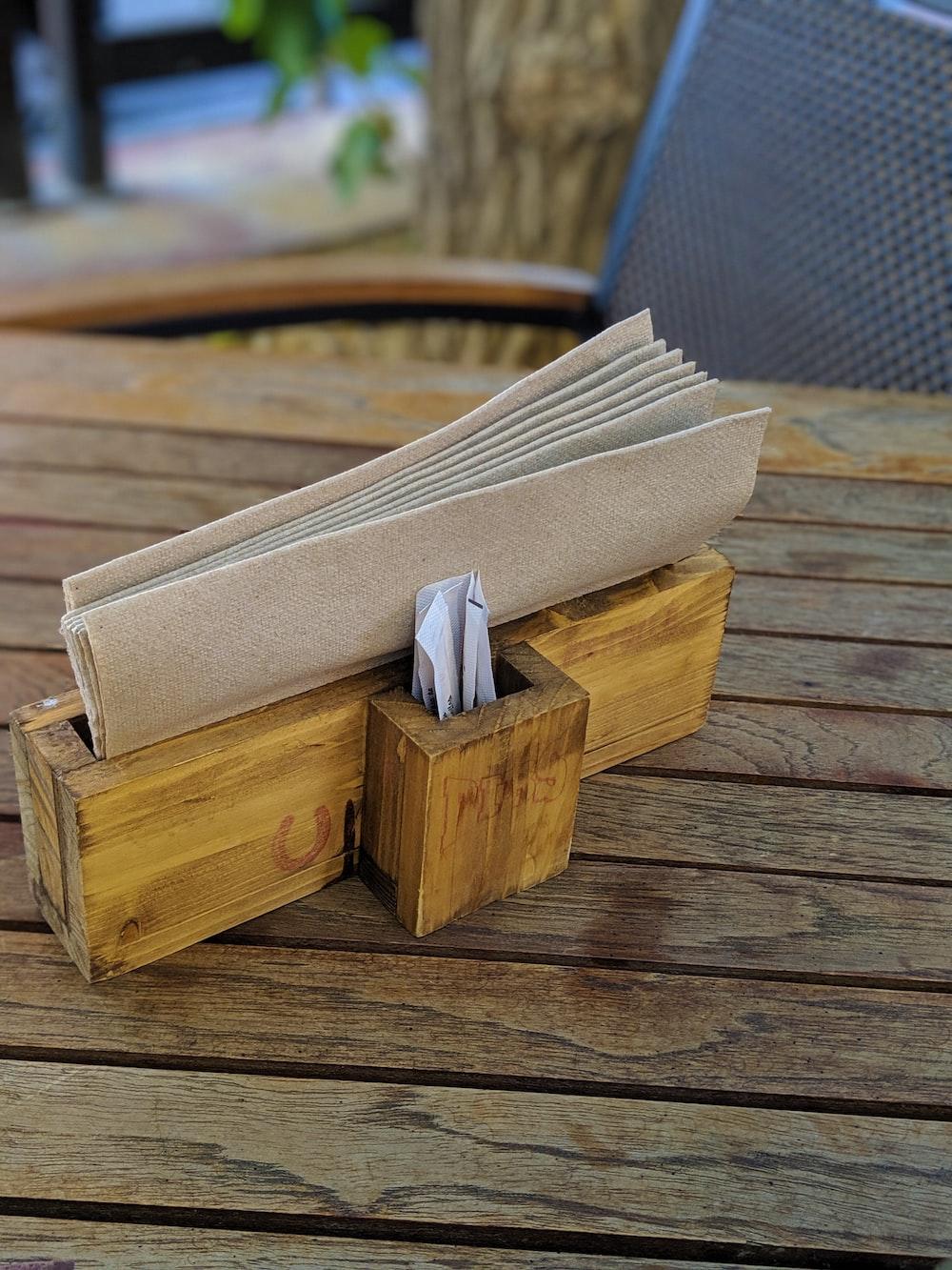 brown tissue in wooden box