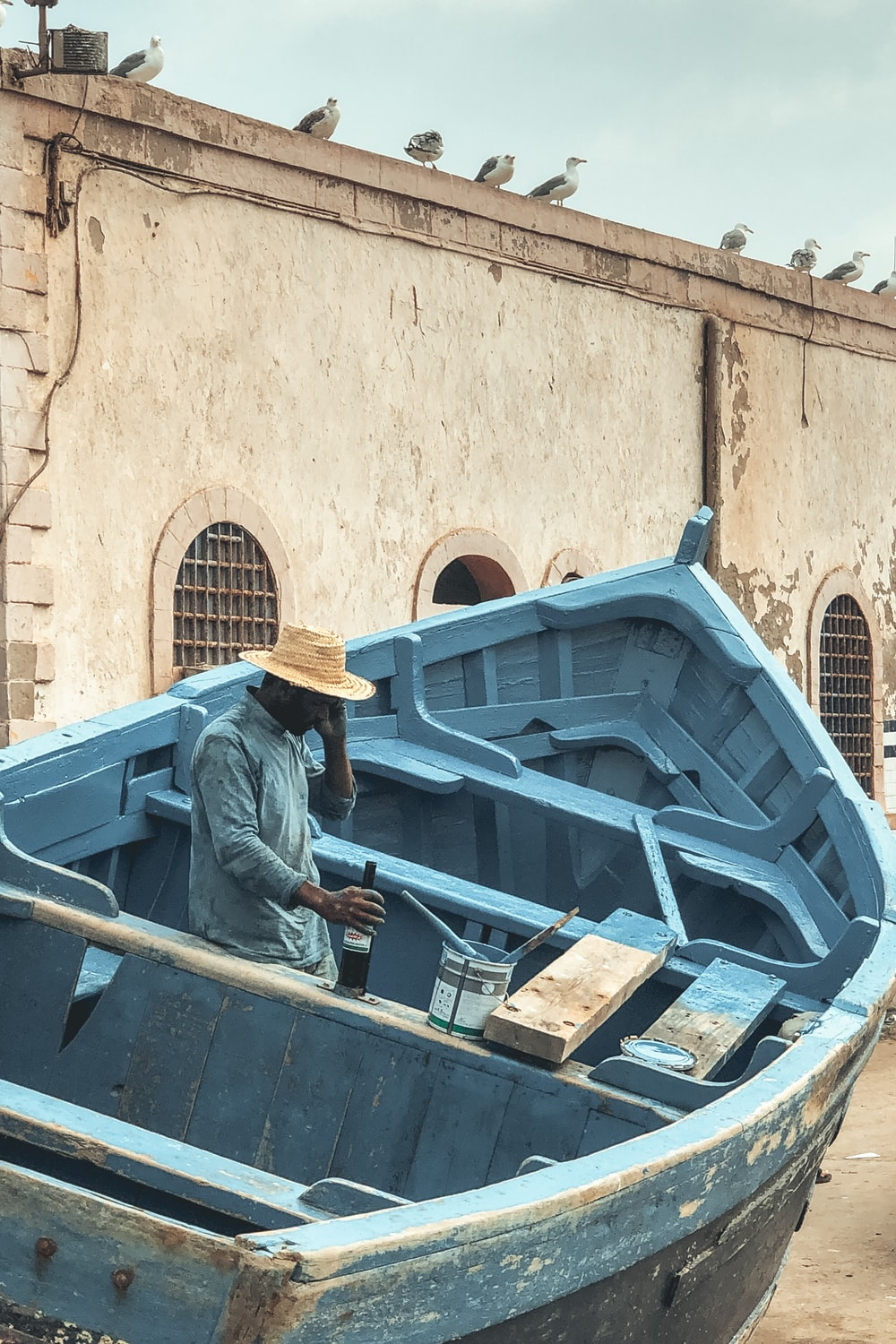 man in teal boat