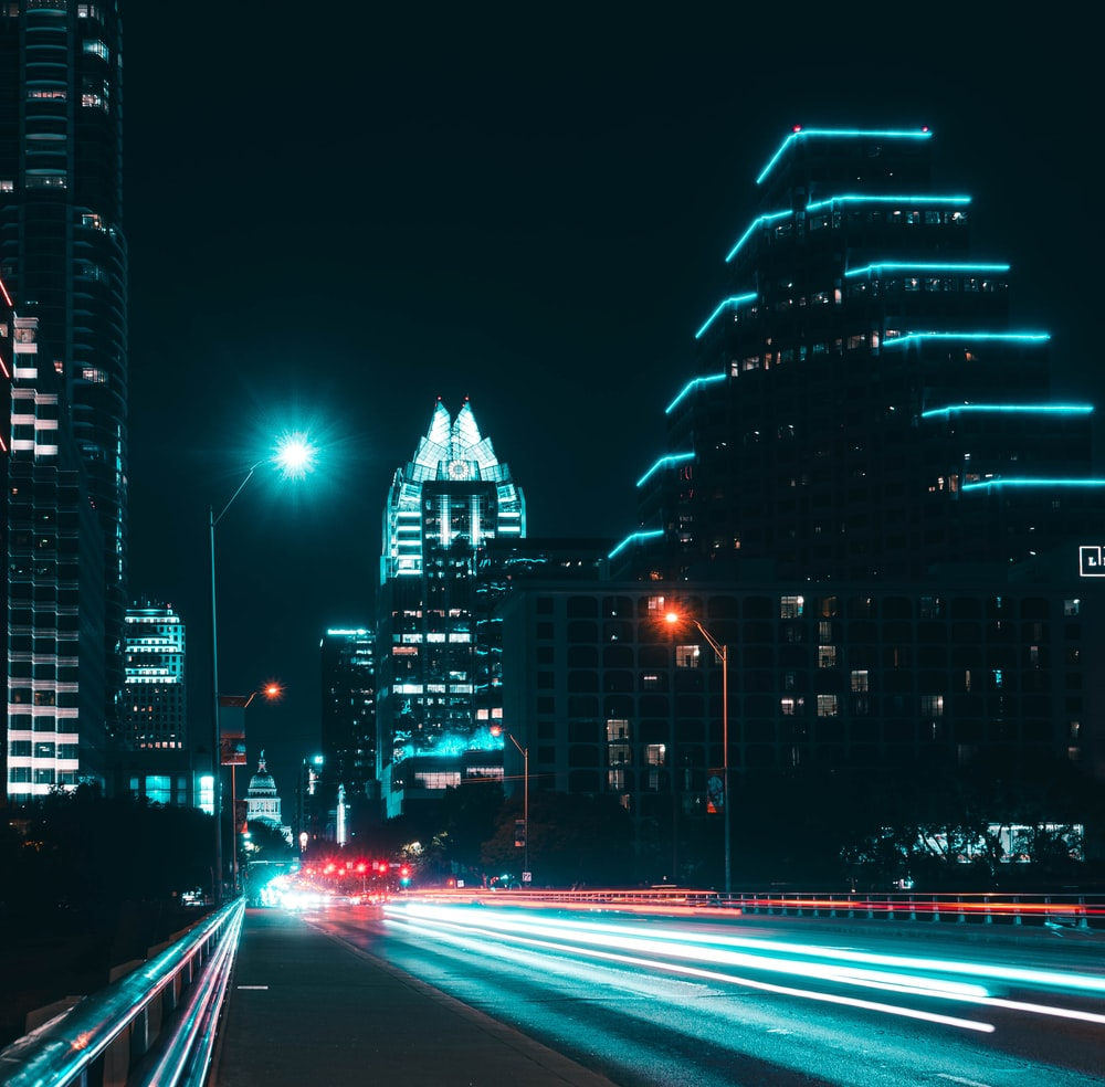 lighted street and high-rise buildings
