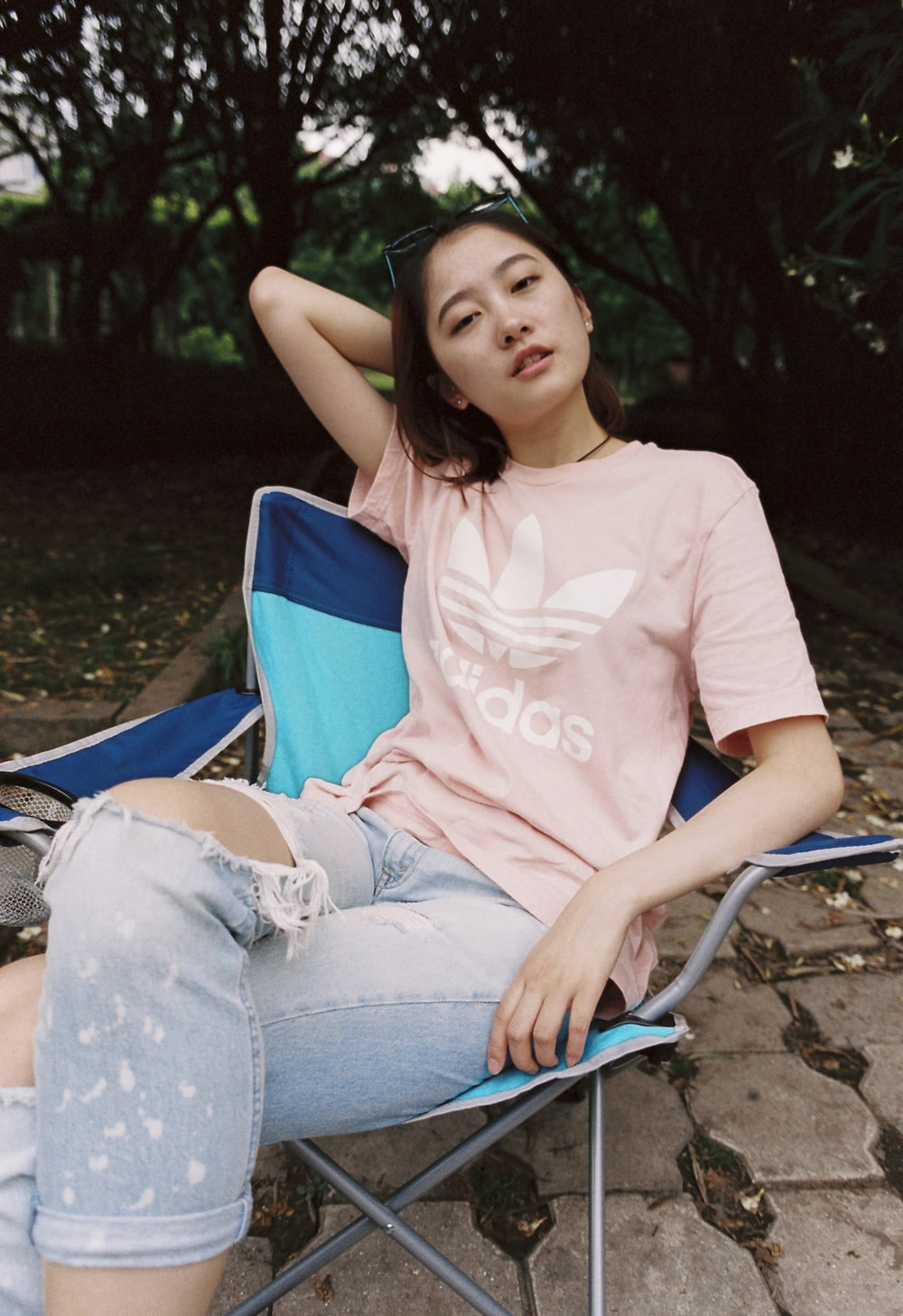 woman in pink adidas crew-neck T-shirt
