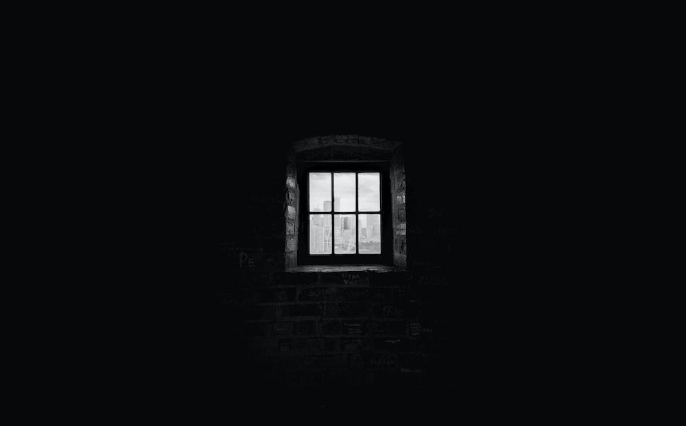 greyscale photography of window