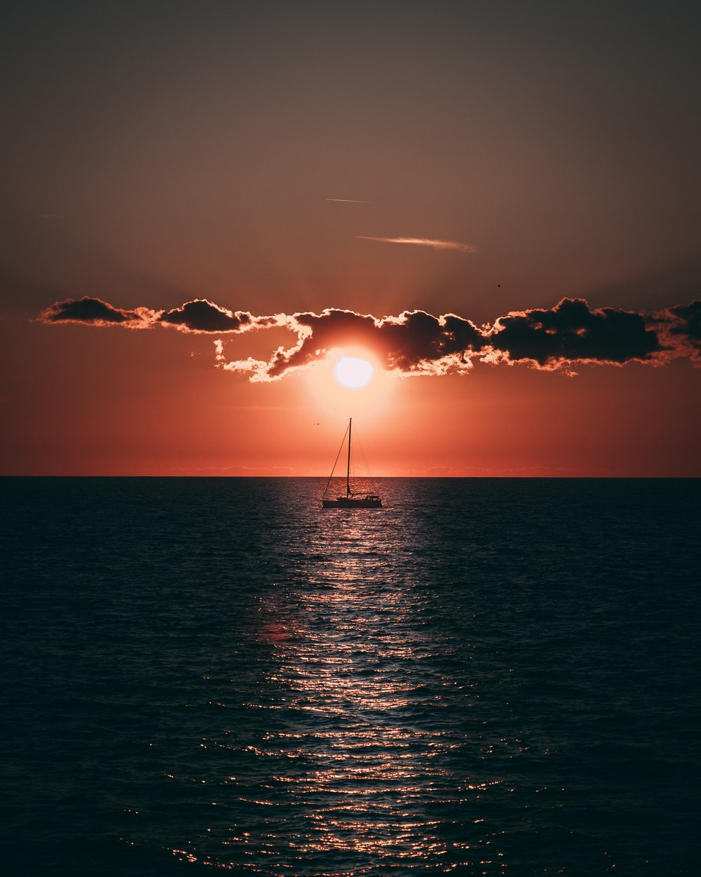 sailboat in sea during golden hour