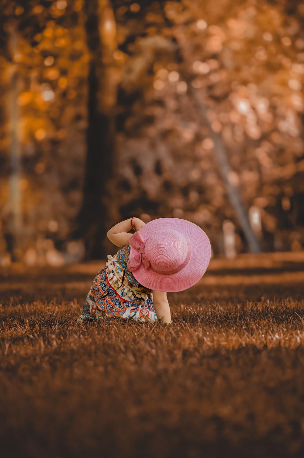 girl wearing pink hat