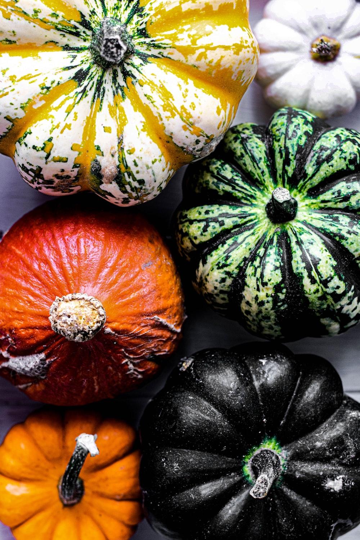 six assorted-colored squash