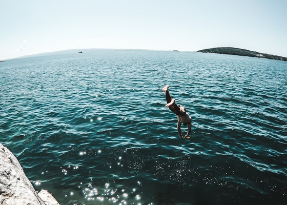 man jumping off the cliff