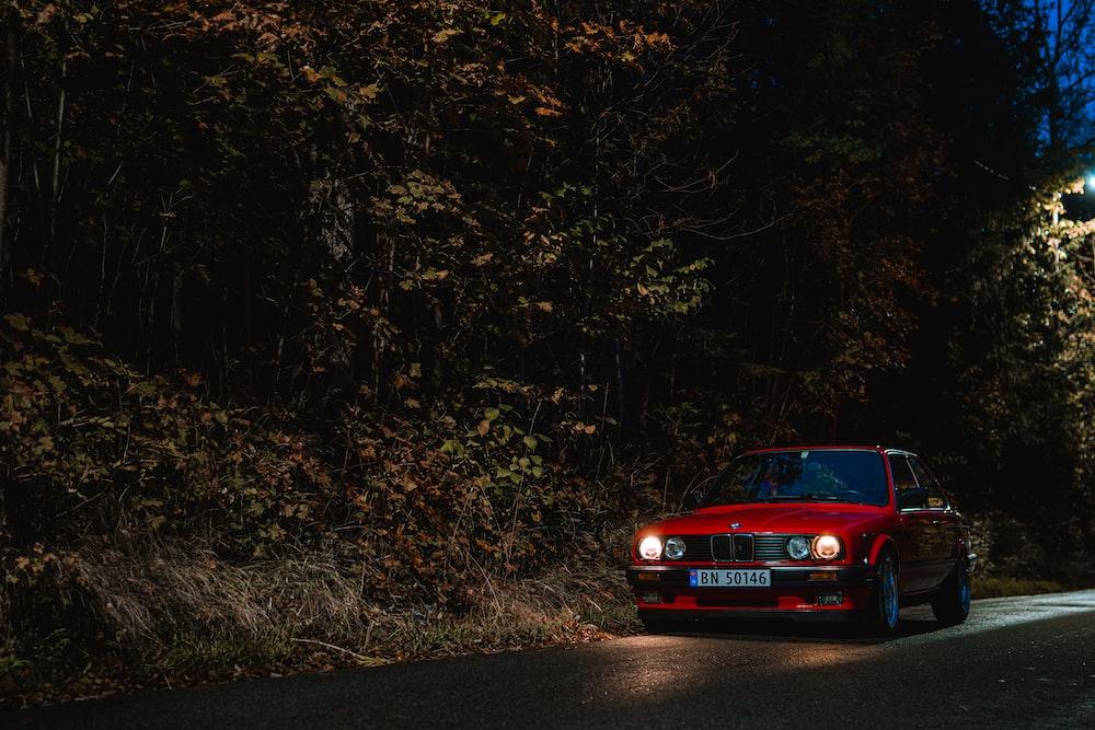 parked red sedan