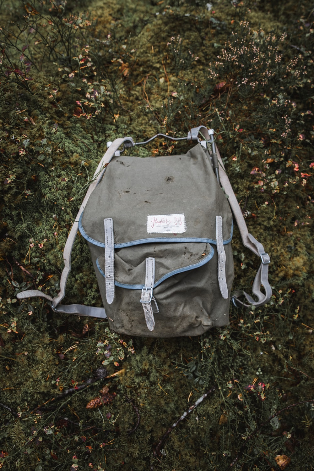 grey and blue backpack on the grass field