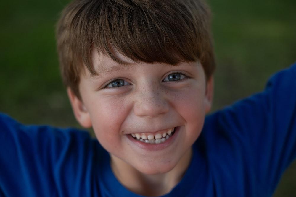 boy's blue crew-neck shirt