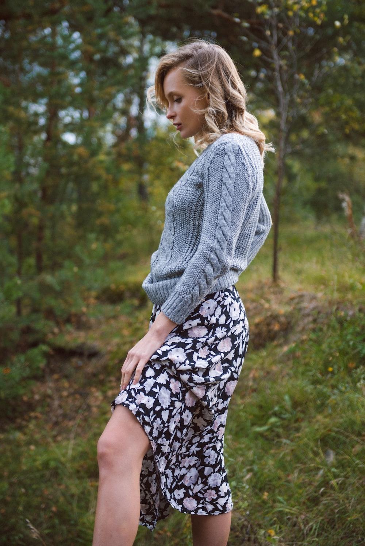 woman wears blue knit sweater