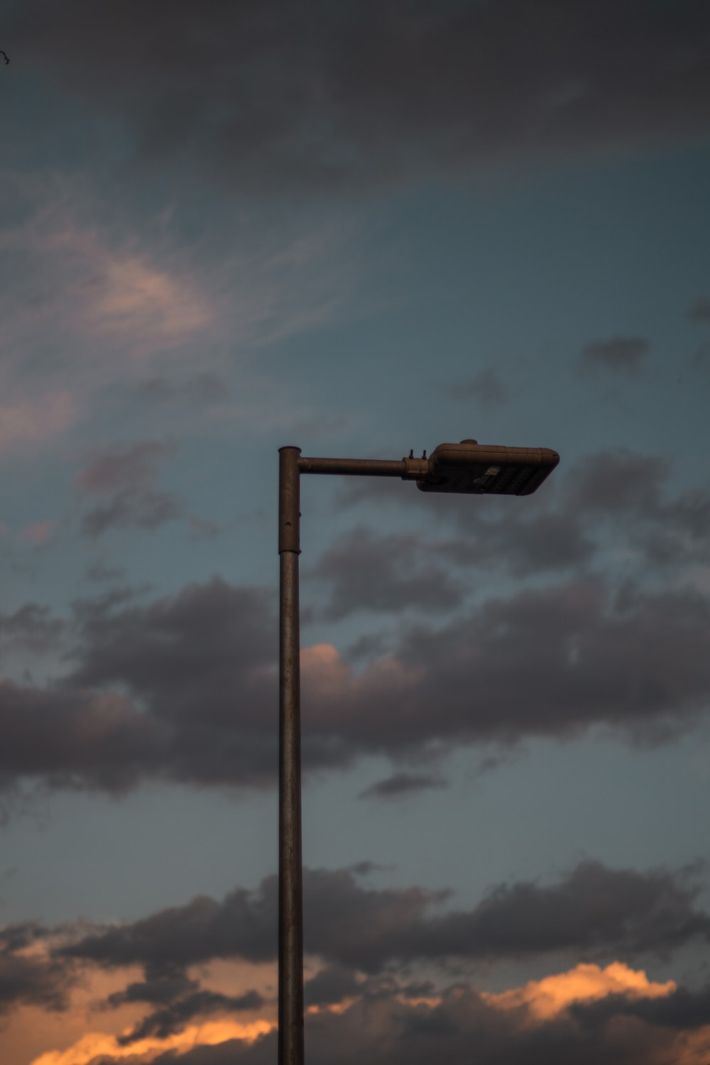 turned-off light post during golden hour